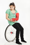 Girl with wheel and plaster cast Royalty Free Stock Images
