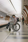 Girl in wheelchair in subway Royalty Free Stock Photo
