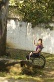 Girl in Wheelchair - Vertical Royalty Free Stock Photos