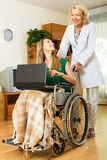 Girl in wheelchair  working on laptop Royalty Free Stock Images