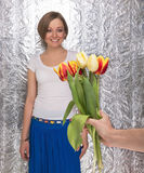 Girl which give a bouquet of tulips Stock Images