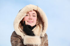 Girl which leans chin on hand in winter Royalty Free Stock Photography