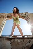 The girl which wishes to jump. The girl costs at a window looks forward and the sun shines Royalty Free Stock Photography