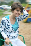 Girl Whirling On Carousel Royalty Free Stock Photo