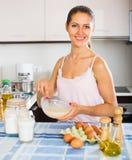Girl whisking eggs for omelette Royalty Free Stock Photos