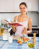 Girl whisking eggs for omelette Royalty Free Stock Photo