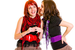 Girl whispering gossips in ear her girlfriend Royalty Free Stock Photos