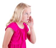 Girl whispering a secret Royalty Free Stock Images