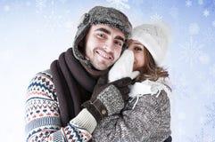Girl whispering a secret boyfriend's ear. Stock Images