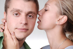 A girl whispering something tenderly to her boyfri Stock Photo