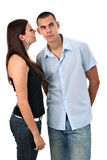 Girl whispers into her boyfriend's ear isolated Royalty Free Stock Photo