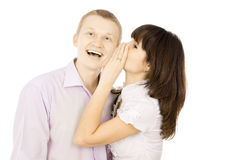 The girl whispers to the guy in the ear Stock Photo