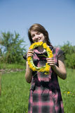 Girl whit chaplet. Long-haired teen girl whit chaplet against a meadow Royalty Free Stock Photography