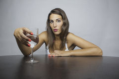 Girl whit a glass Stock Images