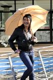 Girl whit umbrella. Smiling young girl relax outdoor whit umbrella royalty free stock photo