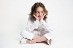 Girl in white. Teenager girl in white, sitting, thinking, smiling Stock Photos