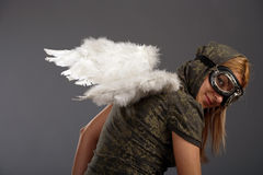 The girl with white angelic wings. And glasses Stock Images