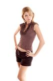 Girl on white background. Blonde long-haired girl in shorts on white background royalty free stock photography