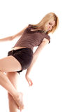 Girl on white background. Blonde long-haired girl in shorts on white background royalty free stock images
