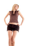 Girl on white background. Blonde long-haired girl in shorts on white background stock photography