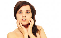 Girl on a white background. Touches a hand to the face Royalty Free Stock Photos