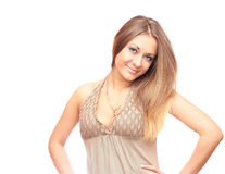 Girl on a white background. Beautiful girl with long hair in a beige dress on a white background Stock Photography