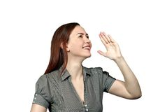 All come here!. Girl on a white background smiling holding her hand in front of her and screaming or calling someone Stock Photos