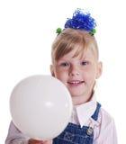 Girl with white balloon. Stock Image