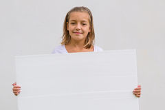 Girl with white banner Royalty Free Stock Image