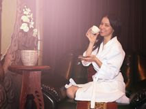 Girl in a white Bathrobe after a massage at the Spa stock photos