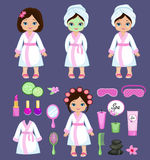 Girl in white bathrobe takes spa treatments. Royalty Free Stock Images