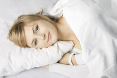 Girl in a white bed Royalty Free Stock Image