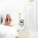 Girl in a white bedroom Stock Image