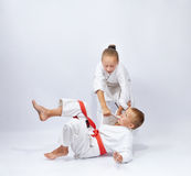 The girl with a white belt makes throws judo Stock Image