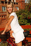 Girl in white with bicycle Royalty Free Stock Photography