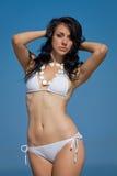 Girl in white bikini on background of sky Royalty Free Stock Photo