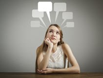 Girl in white and blank speech bubbles. Royalty Free Stock Photography