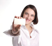 Girl in a white blouse with a card in a hand Stock Image