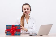 Girl in a white blouse with a headset on his head sitting in fro Stock Photos