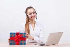Girl in a white blouse with a headset on his head sitting in fro Stock Photography