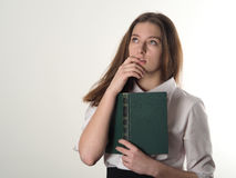 The girl in a white blouse with an old book teaches poetry stock photos