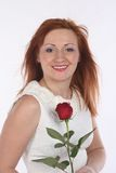 Girl with a rose. Girl in a white blouse with a rose on a white Royalty Free Stock Images