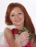 Girl with a rose. Girl in a white blouse with a rose on a white Royalty Free Stock Photo