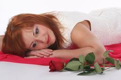 Girl with a rose. Girl in a white blouse with a rose on a white Royalty Free Stock Photos