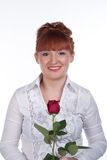 Girl with a rose. Girl in a white blouse with a rose on a white Stock Photography