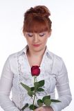 Girl with a rose. Girl in a white blouse with a rose on a white Stock Photos