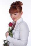 Girl with a rose. Girl in a white blouse with a rose on a white Royalty Free Stock Photography