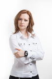 Girl in white blouse standing, arms crossed over Royalty Free Stock Photo