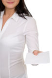 Girl in a white blouse takes the envelope Royalty Free Stock Photography