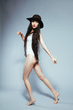 Girl in a white body with a hat. Girl with long hair in a white bodysuit and hat Stock Photos